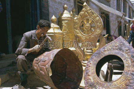metalsmith making temple ornaments lhasa tibet