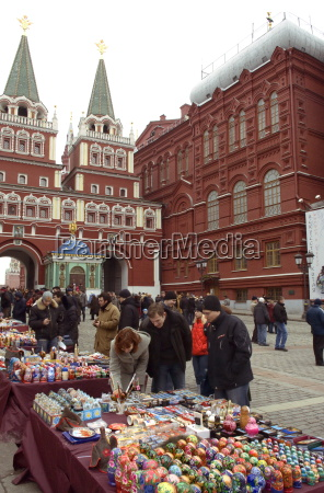tourists look at souvenirs near the
