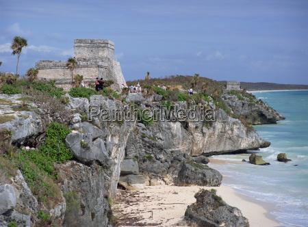 tourists visiting the mayan ruins of