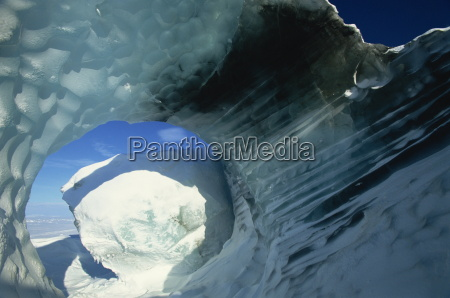 glacial meltwater tunnel in iceberg showing