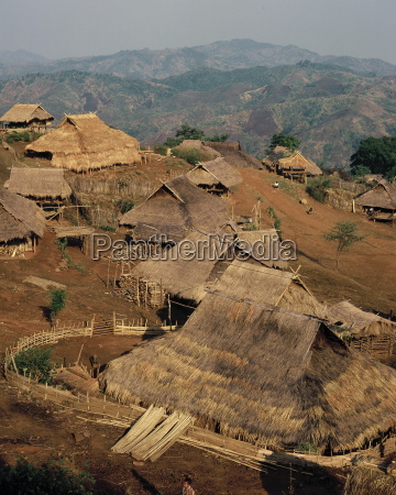 akha hill tribe village with deforested