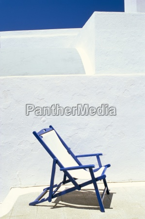 deckchair against whitewashed wall imerovigli santorini