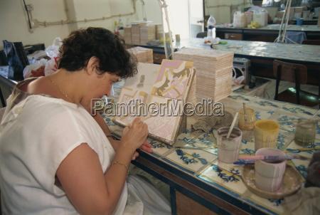 woman painting on tiles santana azulejos