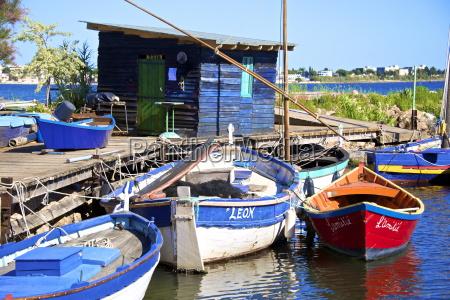 fishing cabin and ancient fishing boats