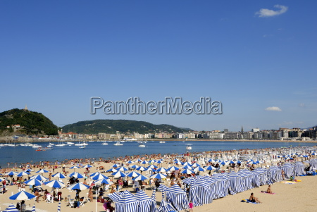 parasols on the beach and town