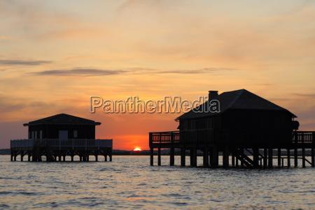 houses on stilts at sunset bay
