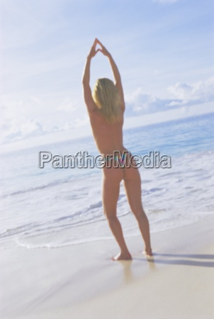 woman stretching on the beach grand