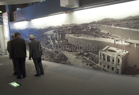 visitors looking at huge wall poster