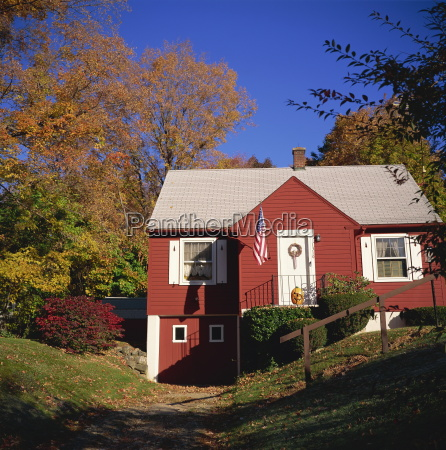 red wooden house with american flag