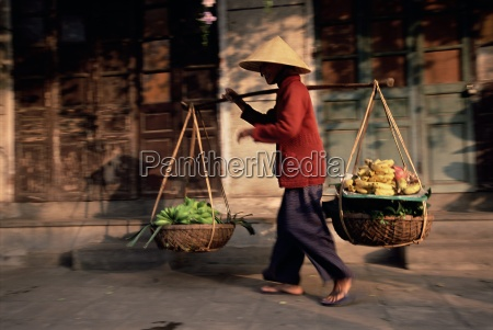 woman carrying fruit and vegetables hoi