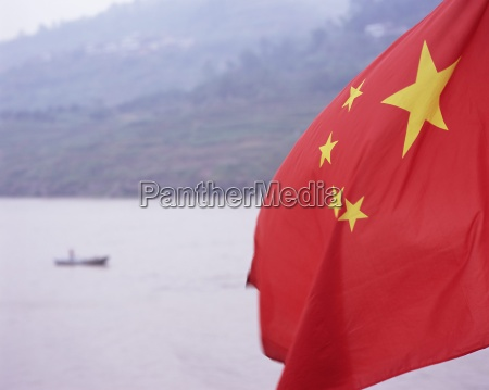 detail of the chinese flag flying