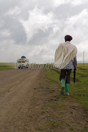 man walking along the road during
