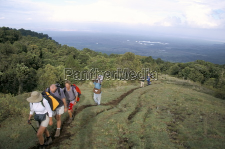 trekkers beginning trek up mount meru