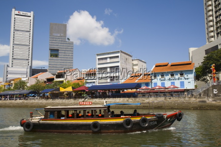 bumboat river taxi passing bars and