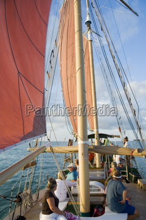 red sails on sailboat that takes