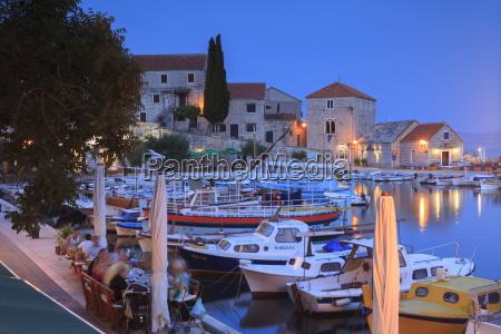 harbour lit up at dusk bol