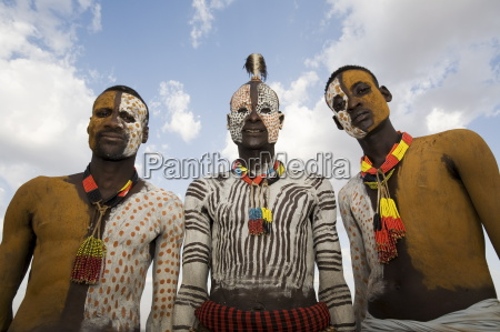 three karo tribesmen with face and