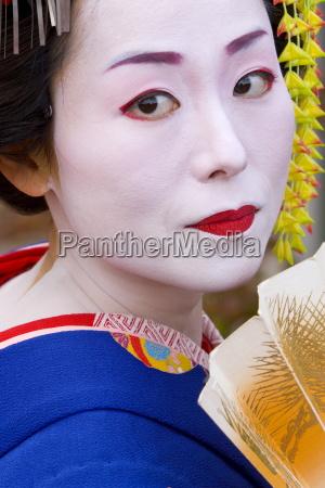 portrait of a geisha holding a
