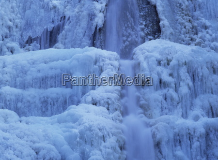 waterfall iced over in winter in