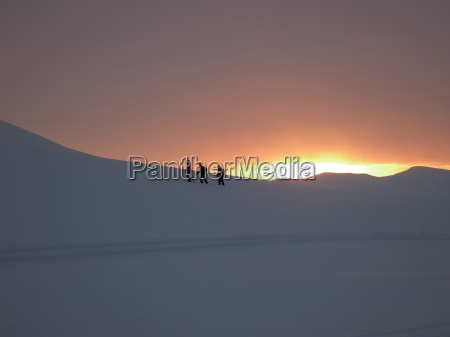 trekking or hiking in winter snow