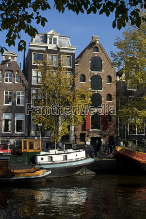 houses along the canal amsterdam netherlands