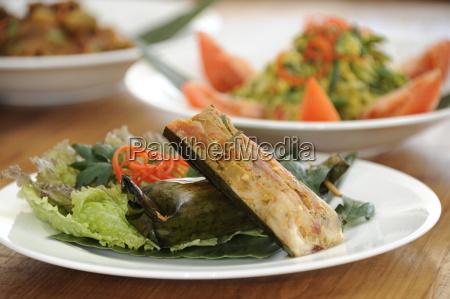 balinese food including ikan pepes fish