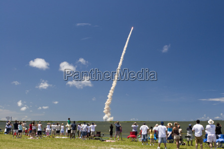 crowds watch launch of space shuttle