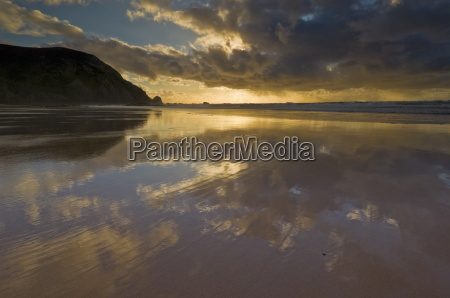 sunset reflected in tidal wash praia
