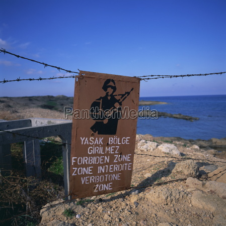 barbed wire and forbidden zone sign