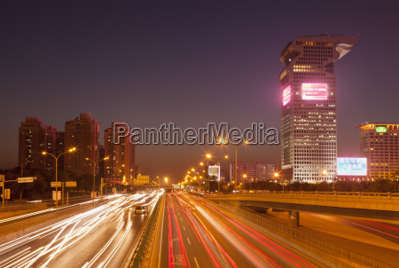 busy traffic and light trails through