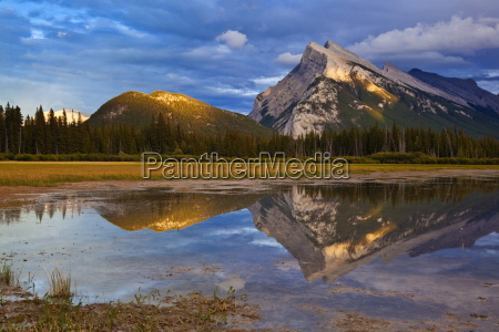 mount rundle rising above vermillion lakes