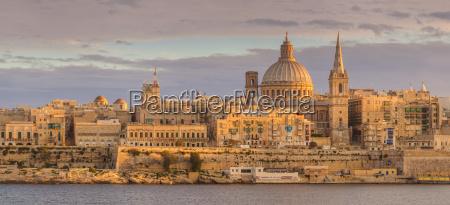 valletta skyline panorama at sunset with