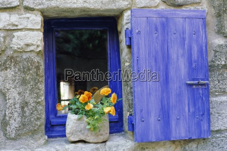 close up of blue shutter window