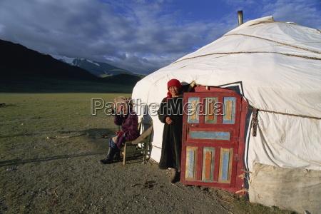 two women outside a ger yurt