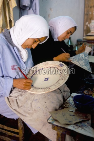 women painting pottery potters village of