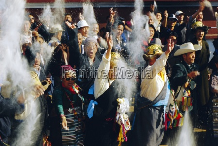 buddhist people throwing flour into the