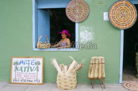 hat seller in the window of