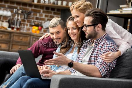 friends using laptop