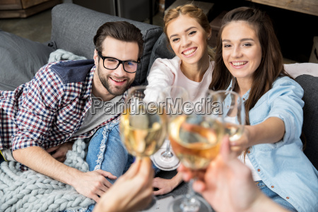 friends cheering with wine