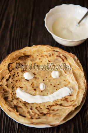 fried tasty smiling pancakes
