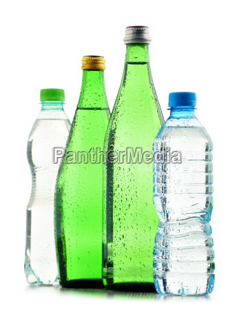 glass and plastic bottles of mineral