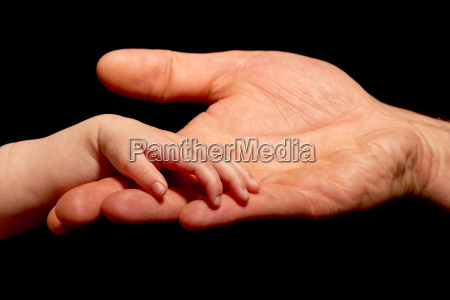 baby trusts in hand holding by