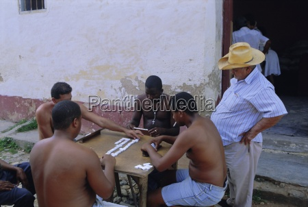 group of men playing dominos trinidad