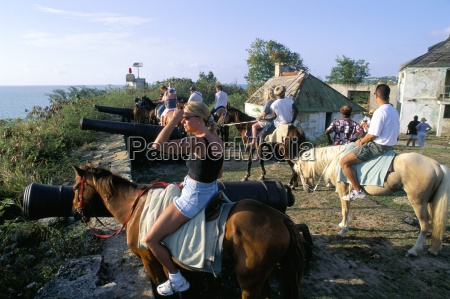 tourists on horseback in historic fort