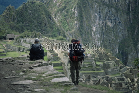 backpackers look at the inca ruins