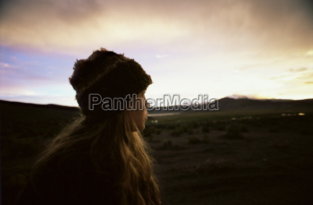 girl looks at the andes as