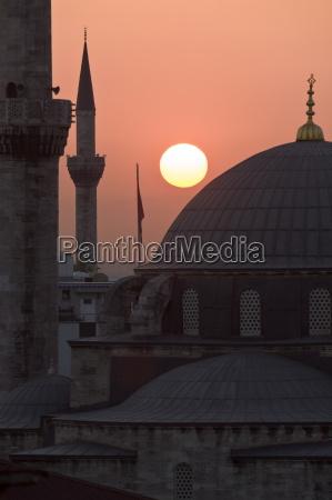 sun setting behind mahamut pasha mosque