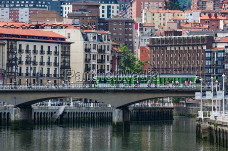 tram crossing the river nervion in