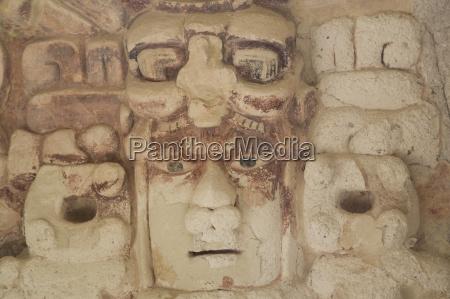 stone mask of mayan sun god