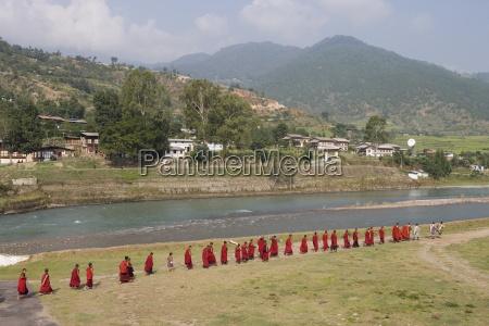 buddhist monks from punakha dzong going
